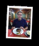 Dan and his massive steak, Iguazu, Argentina[4]